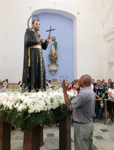 A man prays before the likeness of St. Peter Claver in Cartagena, Colombia, Sept. 9. Pope Francis will speak of the Jesuit saint Sept. 10 while visiting the coastal city. (CNS/David Agren)