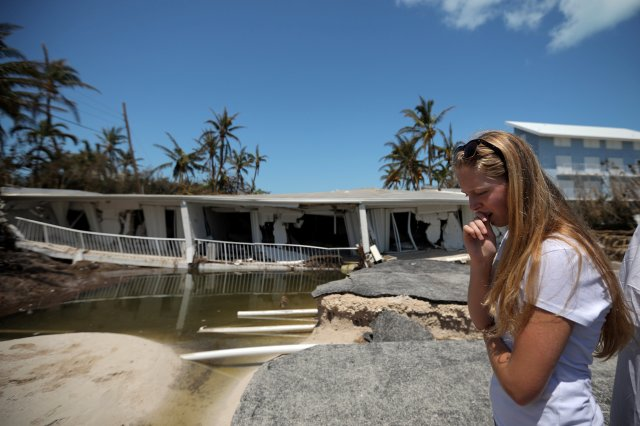 A woman reacts as she sees her destroyed home Sept. 12 in the aftermath of Hurricane Irma in Islamorada in the Florida Keys. (CNS/Reuters)