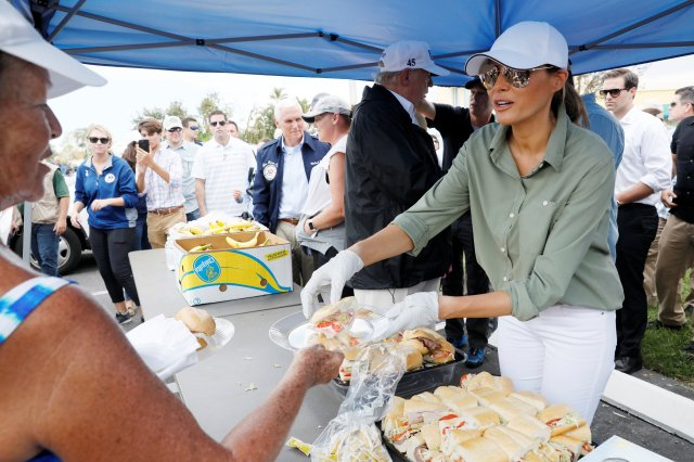 U.S. first lady Melania Trump and President Donald Trump hand out sandwiches to Hurricane Irma victims Sept. 14 during their tour of storm recovery efforts in Naples, Fla. (CNS/Reuters)