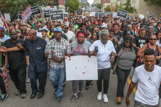 Anthony Lamar Smith's mother, Annie, center, walks with family and protesters during a peaceful rally Sept. 17 after a not guilty verdict in the murder trial of former St. Louis police officer Jason Stockley, charged with the 2011 fatal shooting of the younger Smith. (CNS/Reuters)