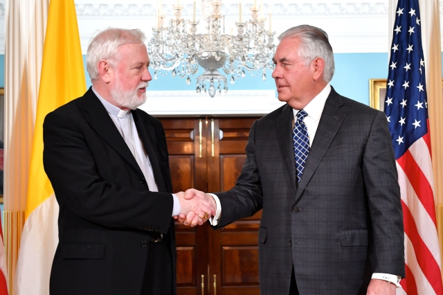Archbishop Paul R. Gallagher, Vatican foreign minister, is greeted by U.S. Secretary of State Rex Tillerson Sept. 26 at the State Department in Washington. The previous day Archbishop Gallagher spoke at United Nations headquarters in New York. (CNS/courtesy State Department)