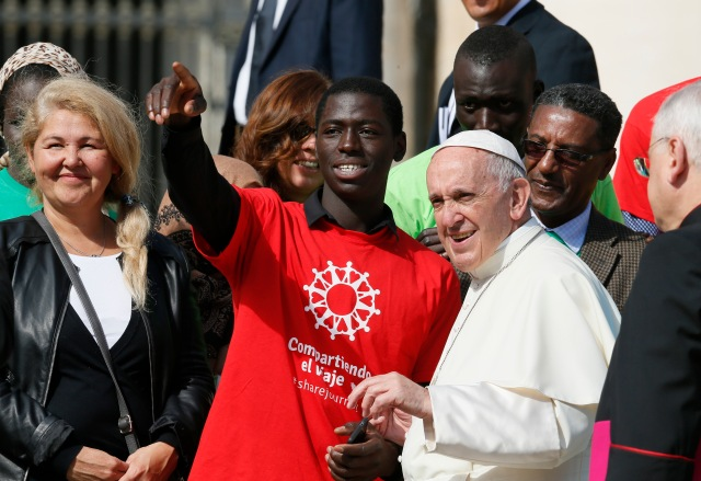 Pope Francis meets immigrants and representatives of Caritas Internationalis during his general audience in St. Peter's Square at the Vatican Sept. 27. Caritas Internationalis was kicking off its