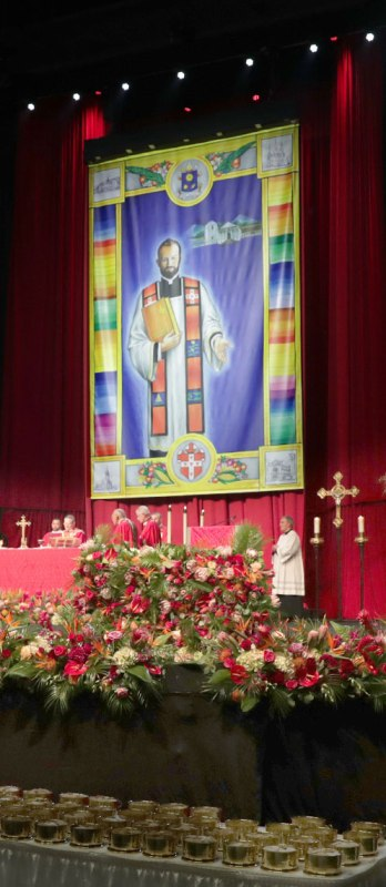 A banner with a likeness of Blessed Stanley Rother and an image of his Guatemalan mission hangs behind the altar at the Oklahoma priest's beatification Mass in Oklahoma City Sept. 23. (CNS photo/Dave Crenshaw, Eastern Oklahoma Catholic)