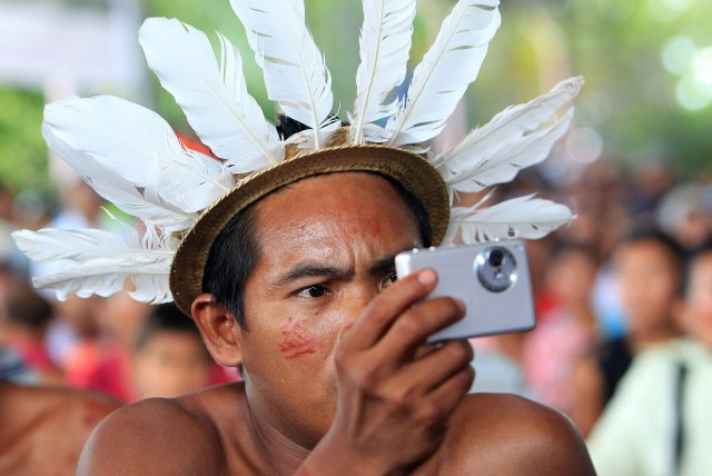 An indigenous member of the Desano ethnic group handles a camera during a meeting in Mitu, Colombia, last year. (CNS/EPA)