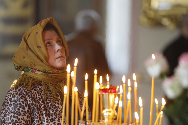 A Russian Orthodox woman prays, gazing at an icon, in an Orthodox parish in St. Petersburg May 29. Orthodox Christianity has been on the rise in Russia since the fall of communism in 1991. (CNS/Robert Duncan)