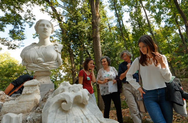 Visitors look at a statue in the Vatican Gardens. The Vatican is involved in a five-year project to develop ecologically friendly cleaning agents and techniques to clean, restore and maintain the 570 works of art, including fountains, statues and stone plaques, on display outside. (CNS/Paul Haring)
