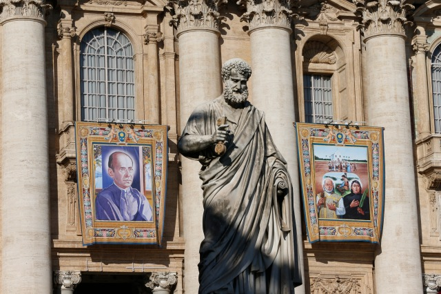 "Banners of Spanish Blessed Faustino Miguez and the ""Martyrs of Natal,"" Brazil, hang from the facade of St. Peter's Basilica at the Vatican Oct. 13 in advance of an Oct. 15 canonization. Martyrs from Mexico and an Italian Capuchin priest also will be canonized by Pope Francis. (CNS/Paul Haring)"