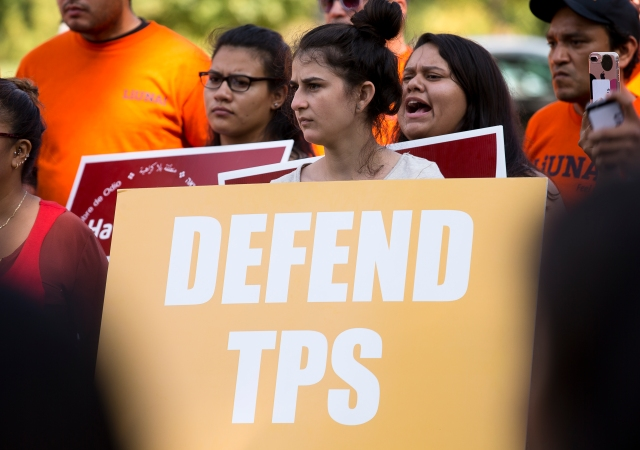 A woman holds a sign showing her support for Temporary Protected Status, or TPS, during a rally near the U.S. Capitol in Washington Sept. 26. (CNS/Tyler Orsburn)