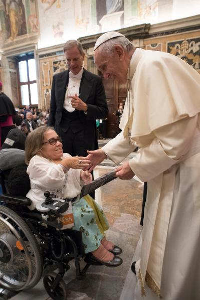 Pope Francis greets a woman in a wheelchair during an audience with catechists and people with disabilities at the Vatican Oct. 21. (CNS/L'Osservatore Romano)