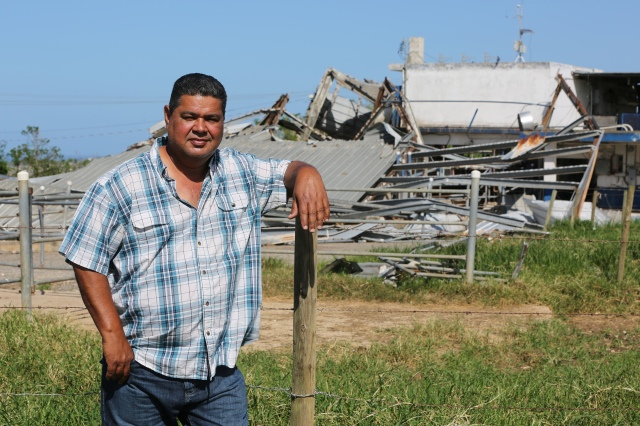 Catholic dairy farmer Gustavo Toledo stands near his destroyed farm buildings Oct. 22 in Hatillo, Puerto Rico, more than one month after Hurricane Maria devastated the island. (CNS/Bob Roller)