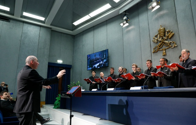 """Members of the Sistine Chapel Choir perform under the direction of Msgr. Massimo Palombella during a press conference for their release of their new CD, """"Veni Domine -- Advent and Christmas at the Sistine Chapel,"""" at the Vatican Oct. 24. (CNS/Paul Haring)"""