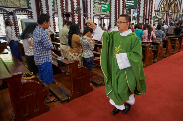 A priest sprinkles Holy Water on faithful at St. Mary's Cathedral in Yangon, Myanmar, Oct. 15. Pope Francis will visit the southeast Asian country Nov. 27-30. (CNS/Paul Jeffery)