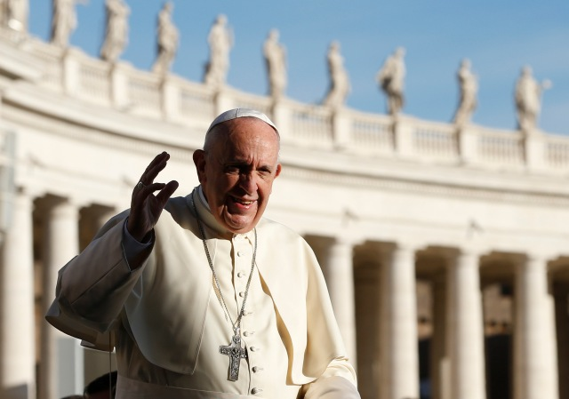 Pope Francis greets the crowd during his general audience in St. Peter's Square at the Vatican Oct. 25. (CNS/Paul Haring)
