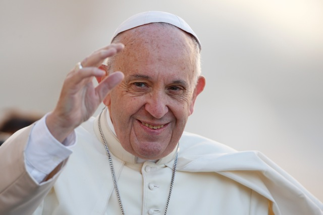 Pope Francis waves as he arrives to lead his general audience in St. Peter's Square at the Vatican Oct. 25. (CNS/Paul Haring)