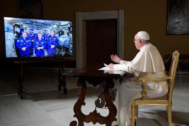 Pope Francis speaks from the Vatican to astronauts aboard the International Space Station Oct. 26. The pope connected for about 25 minutes to astronauts 250 miles above the earth. (CNS/L'Osservatore Romano)