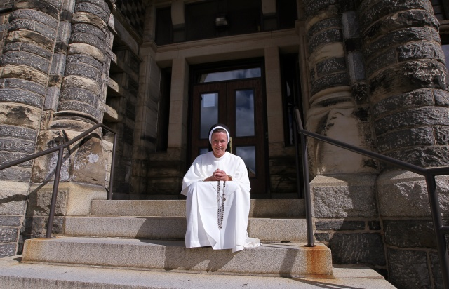 Sister Anna Wray, a Dominican Sister of St. Cecilia, poses for a photo on the campus of The Catholic University of America in Washington. (CNS/Tyler Orsburn)