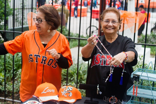 Parishioners sell handmade rosaries to baseball fans outside Annunciation Catholic Church in downtown Houston Oct. 27. The church, built in 1869, sits across the street from Minute Maid Park. (CNS/James Ramos, Texas Catholic Herald)