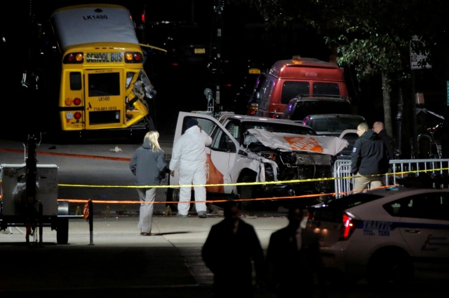 Police investigate the crime scene early Nov. 1 after a man driving a rented pickup truck ran down pedestrians and cyclists on a bike path alongside the Hudson River in New York City. (CNS/Reuters)