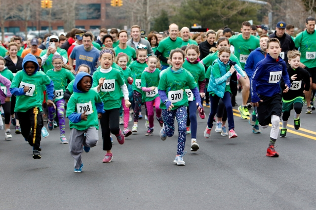 Children begin a fun run last March in the streets near St. Joseph School in Garden City, N.Y. (CNS/Gregory A. Shemitz)