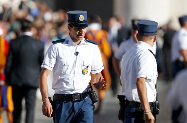 Vatican police offers protect Pope Francis during his general audience in St. Peter's Square at the Vatican Sept. 20. The Vatican police force was established 200 years ago, but its origins were in the fourth century. (CNS/Paul Haring)