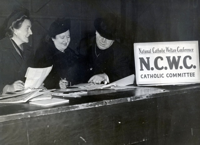 A clergyman and women with the National Catholic Welfare Conference are pictured in an undated photo. The conference, which was founded as a council, was the precursor to the U.S. Conference of Catholic Bishops. (CNS file photo)