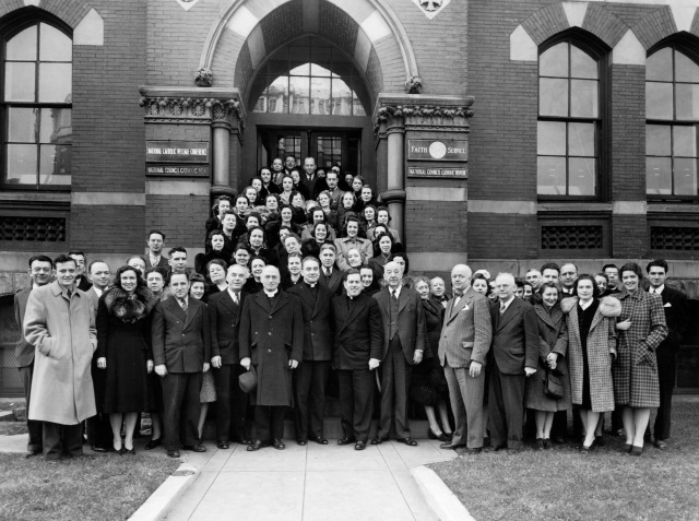 Clergy members and laypeople pose in this undated photo outside the headquarters of the National Catholic Welfare Conference in Washington. The conference was the precursor to the U.S. Conference of Catholic Bishops. (CNS file photo)