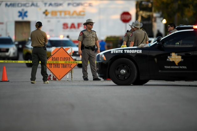 Law enforcement officers stand near the scene of the mass shooting Nov. 5 at the First Baptist Church in Sutherland Springs, Texas. (CNS/Reuters)