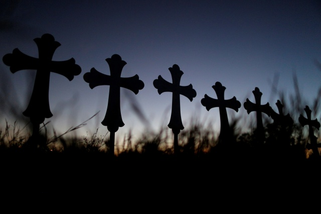 Crosses are seen near a vigil Nov. 6 in memory of the victims killed in the shooting at the First Baptist Church of Sutherland, Texas. (CNS/Reuters)