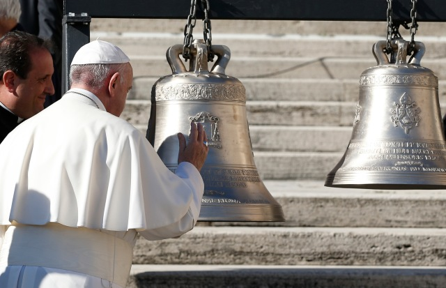 Pope Francis blesses bells during his general audience in St. Peter's Square at the Vatican Nov. 8. (CNS/Paul Haring)