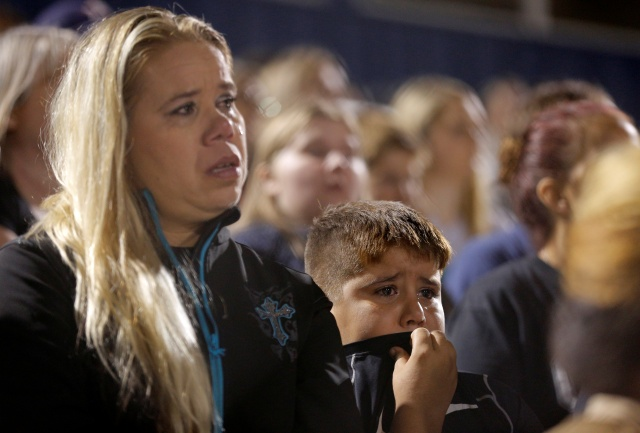 A woman and boy cry during a Nov. 7 vigil in La Vernia, Texas, in memory of those killed in the shooting at the First Baptist Church of Sutherland Springs, Texas. (CNS/Reuters)