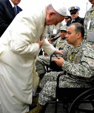Pope Francis greets Edwin Restrepo, a retired marine, Sept. 8 in Colombia.(CNS/courtesy of Colombian Navy)