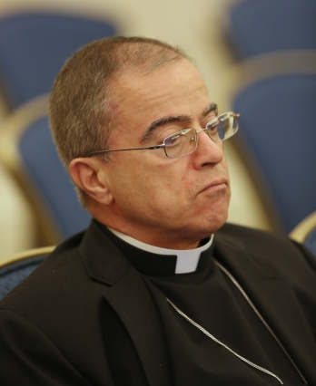 Archbishop Roberto Gonzalez Nieves of San Juan, Puerto Rico, listens to a speaker Nov. 14 during the fall general assembly of the U.S. Conference of Catholic Bishops in Baltimore. (CNS/Bob Roller)