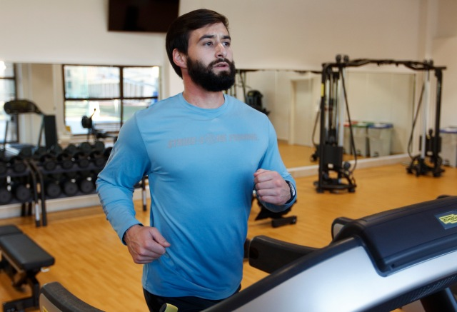 Michael Caraway, a seminarian from Diocese of Lake Charles, La., uses a treadmill in the new gym at the Pontifical North American College in Rome. Caraway said he got to know many of his brother seminarians while working out. (CNS/Robert Duncan)