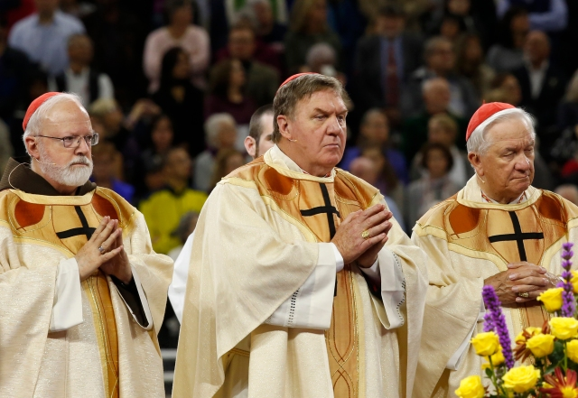 Cardinals Sean P. O'Malley of Boston, Joseph W. Tobin of Newark, N.J., and Adam J. Maida, retired archbishop of Detroit, concelebrate the beatification Mass of Blessed Solanus Casey Nov. 18 at Ford Field in Detroit. (CNS/Jeff Kowalsky, courtesy Michigan Catholic)