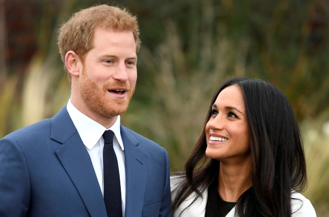 Britain's Prince Harry poses with Meghan Markle Nov. 27 in the Sunken Garden of Kensington Palace in London after announcing their engagement. Markle attended Immaculate Heart High School in Los Angeles. (CNS/Reuters)