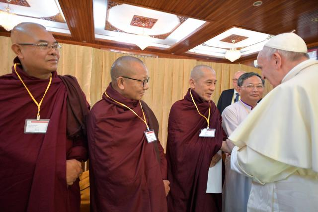 Pope Francis greets members of the Buddhist community during a small informal meeting with a variety of religious leaders Nov. 28 at the archbishop's residence in Yangon, Myanmar. (CNS/L'Osservatore Romano)