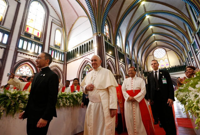 Pope Francis arrives with Cardinal Charles Bo of Yangon to celebrate Mass with young people at St. Mary's Cathedral in Yangon, Myanmar, Nov. 30. (CNS/Paul Haring)