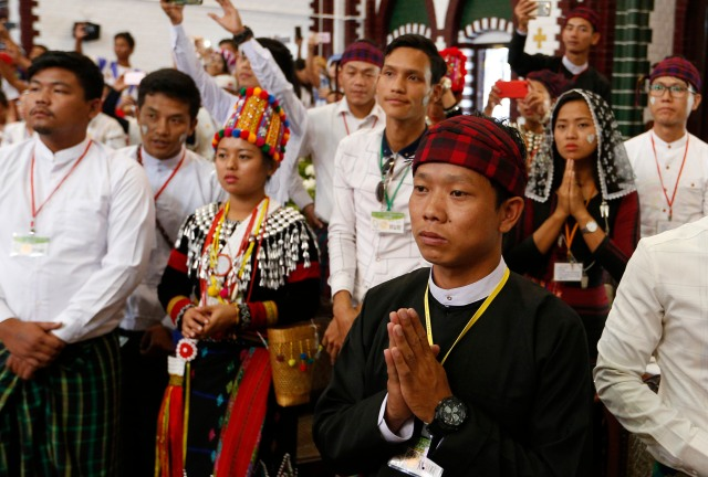 Young people react as Pope Francis arrives to celebrate Mass with youths at St. Mary's Cathedral in Yangon, Myanmar, Nov. 30. (CNS/Paul Haring)