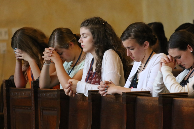 Campers pray in the chapel in early July during the Quo Vadis Camp at Immaculate Conception Seminary in Huntington, N.Y. Seventy-six teenagers from the dioceses of Rockville Centre and Brooklyn attended the camp, which provided an opportunity for participants to have fun and deepen their faith while encouraging them to be open to God's call to the priesthood or religious life. (CNS/Gregory A. Shemitz, Long Island Catholic)