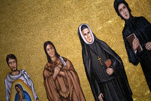 Mosaic tiles depicting St. Juan Diego, St. Kateri Tekakwitha, St. Rose Philippine Duchesne and St. Elizabeth Ann Seton are seen in the Trinity Dome at the Basilica of the National Shrine of the Immaculate Conception in Washington. (CNS/Tyler Orsburn)