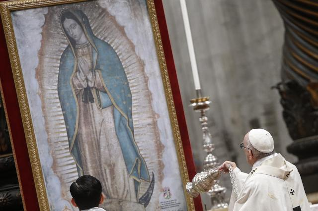 Pope Francis swings a censer in front of an image of Our Lady of Guadalupe as he celebrates Mass Dec. 12 marking her feast day in St. Peter's Basilica at the Vatican. (CNS/EPA)