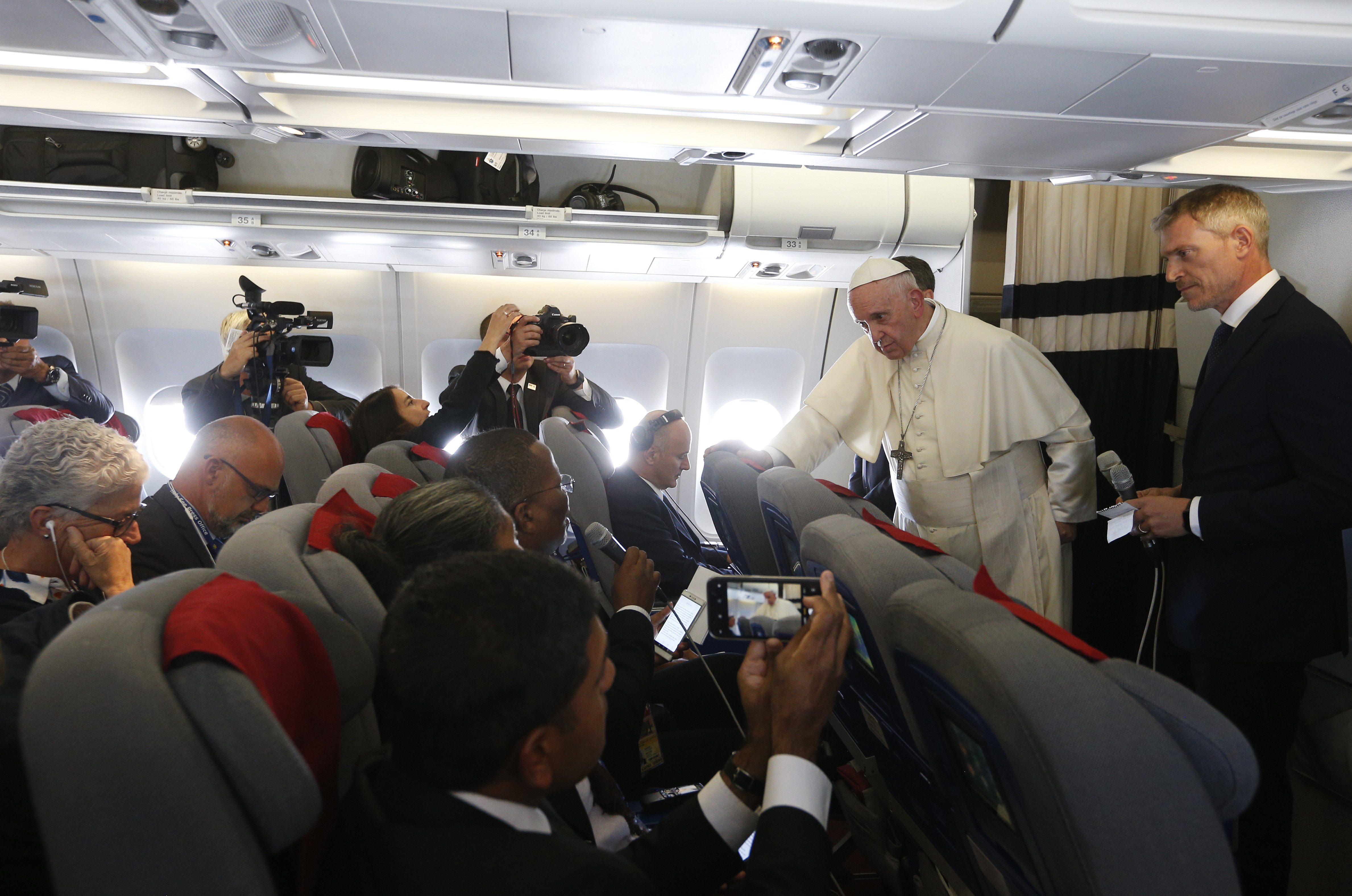 'Just the facts,' pope tells reporters, commenting on news media