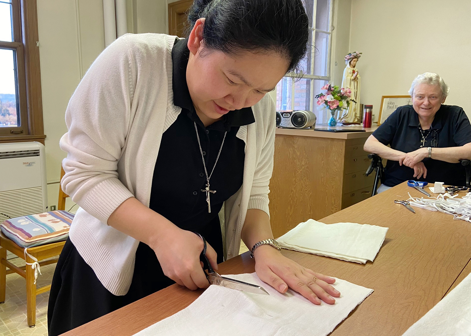 Oregon's 'sewing' sisters, local Catholic community make face masks, gowns